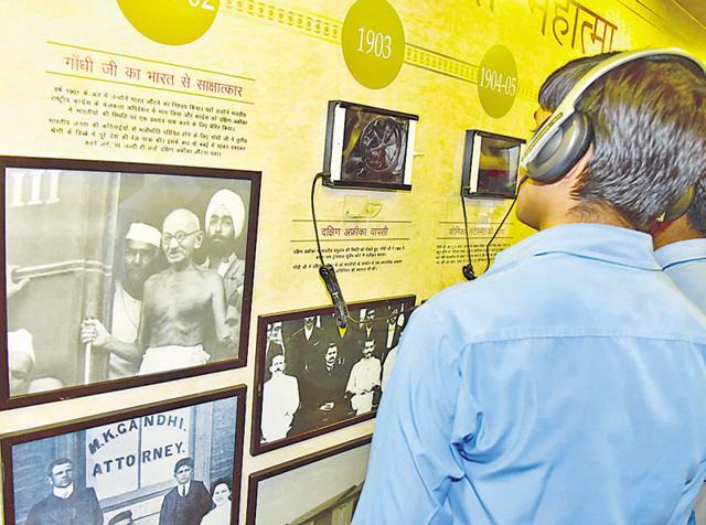 A student looks at exhibits of Mahatma Gandhi's memorabilia at Podar World School in Jaipur on Tuesday.