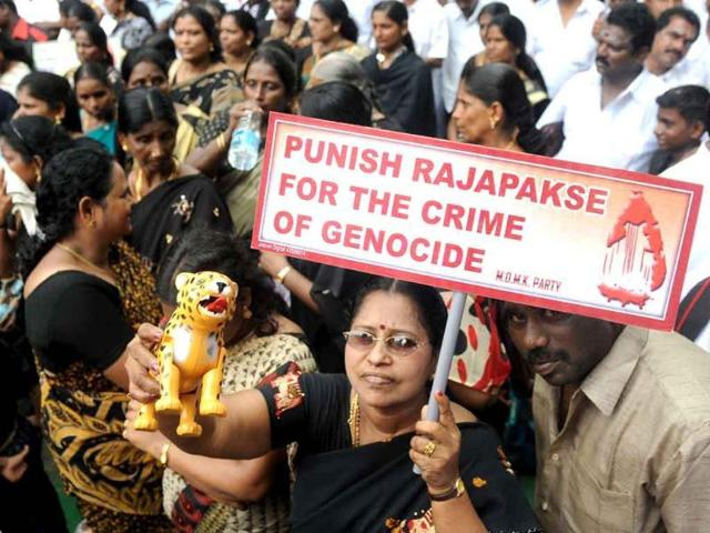 "People from Tamil Nandu and activists from the MDMK party hold placards and a toy tiger during a protest against Sri Lankan President Mahinda Rajapaksa. Allegations that the Sri Lankan army committed war crimes during the bloody conflict with Tamil rebels are ""credible"", a government probe panel has said"