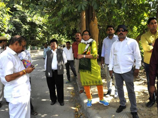 Huda administrator Anita Yadav with her team during an anti-encroachment drive.