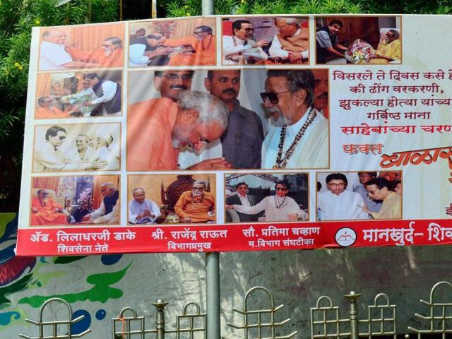 A poster put up by the Shiv Sena in Mumbai. The poster has come under fire from the Congress as it depicts Narendra Modi and Pranab Mukherjee bowing before late Shiv Sena leader, Bal Thackeray