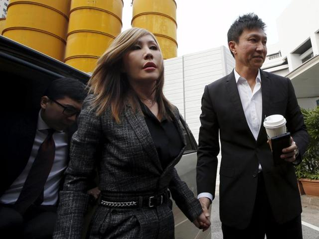 City Harvest Church founder Kong Hee and his wife Sun Ho, also known as Ho Yeow Sun, arrive at the State Courts in Singapore.