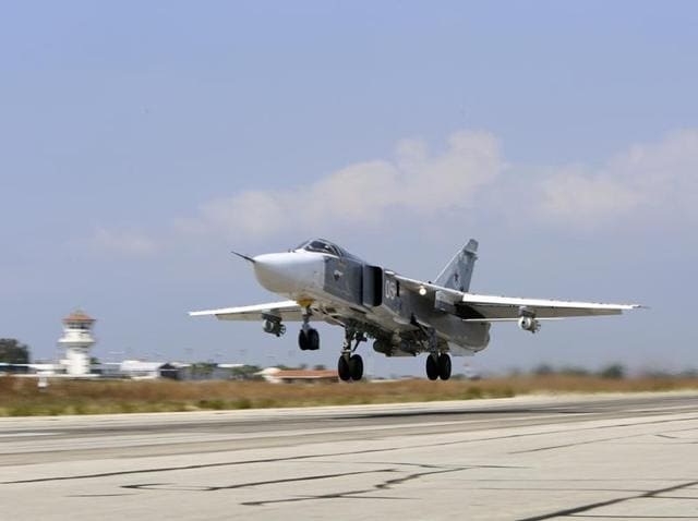 A Russian SU-24M jet fighter armed with laser guided bombs takes off from a runaway at Hmeimim airbase in Syria. Russia and the United States signed an agreement October 20 designed to minimize the risk of collisions and other dangers as both countries carry out airstrikes in Syria.