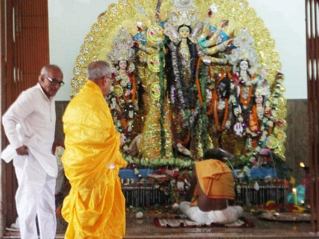 President Pranab Mukherjee in front of a Durga idol during in Birbhum, West Bengal, on Wednesday.