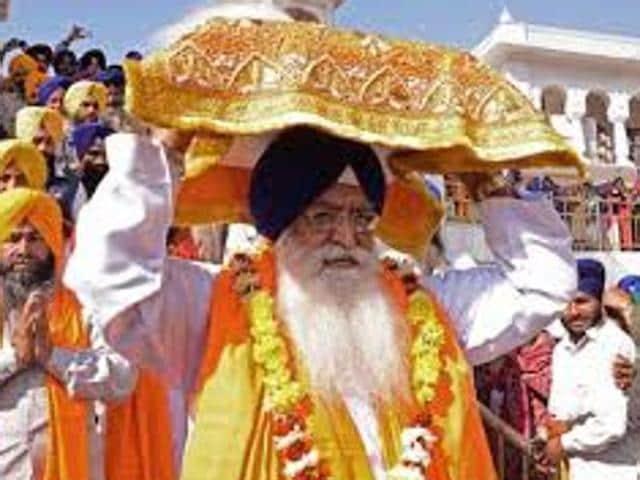 Jathedar Giani Jagtar Singh carrying the Guru Granth Sahib