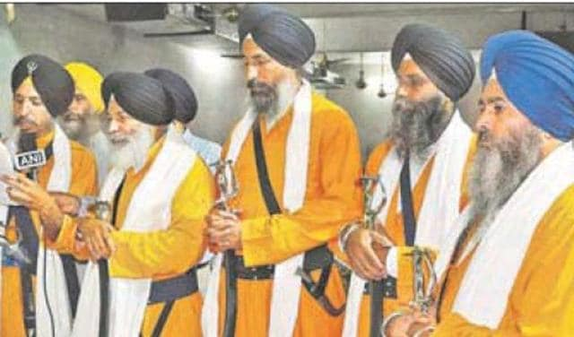 The SGPC designates the 'Panj Pyaras' (above) officially to perform the 'amrit sanchar' (baptism) ceremony and leading 'nagar kirtans' (religious processions) on important occasions.