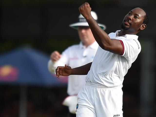 West Indies' Jomel Warrican celebrates after dismissing Sri Lanka's Dhammika Prasad during the first day of the second Test at the P Sara Oval Stadium in Colombo on October 22, 2015.