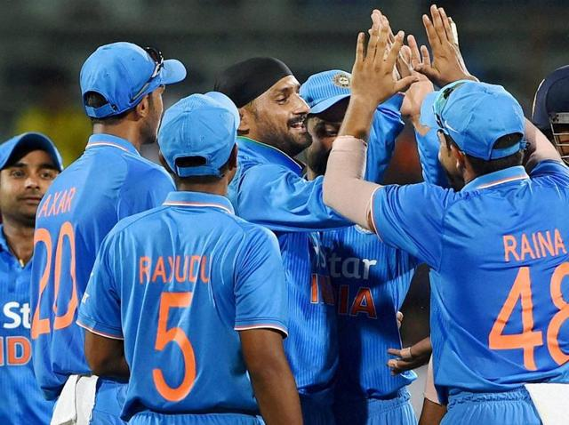 India's Harbhajan Singh celebrates along with teammates after dismissing South Africa's Quinton de Kock during the 4th ODI in Chennai on October 22, 2015.