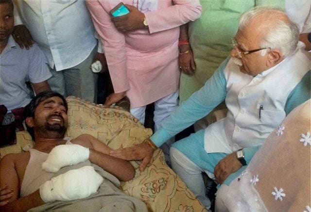 Haryana Chief Minister Manohar Lal Khattar meeting Jitendra whose house was set on fire allegedly by men belonging to the upper-cast community at Superh village in Ballabhgargh in Faridabad on Thursday.
