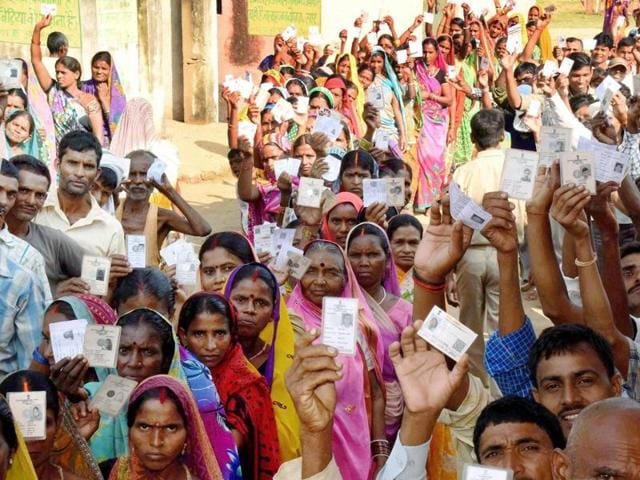 Voters wait in a queue to cast their vote during the second phase of Bihar elections, in Gaya.