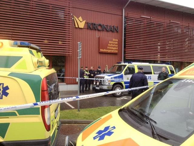 Emergency services attend the scene after a masked man attacked people with a sword, at the Kronan school in Trollhattan, near Goteborg in western Sweden.