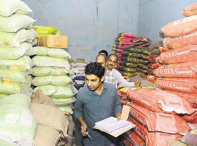 District supply department officials check stock of pulses at Agrasen Market in Kota on Wednesday.