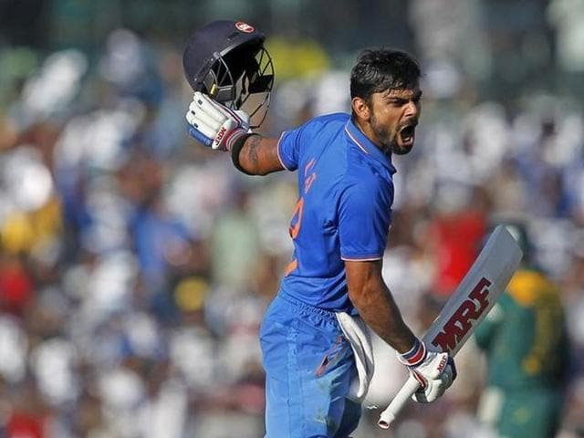 Virat Kohli reacts after scoring his century during their fourth one-day international cricket match against South Africa in Chennai.