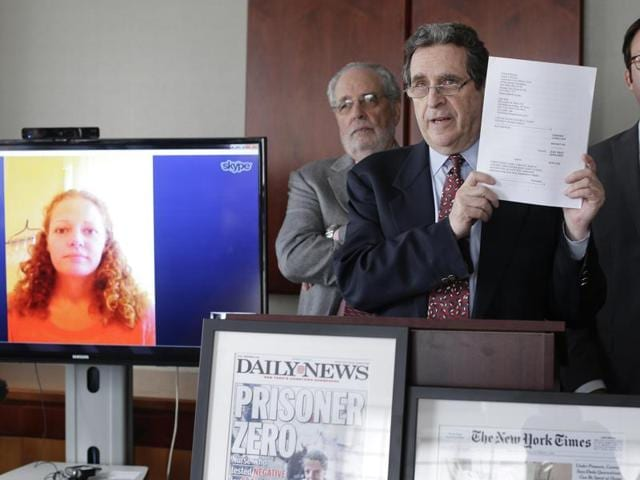 Attorney Norman Siegel (C), along with Udi Ofer (R), executive director of the American Civil Liberties Union of New Jersey and attorney Steven Hyman, answer questions during a news conference, in New York. The ACLU along with two New York law firms, will be representing Kaci Hickox (L) seen via Skype, in filing a lawsuit against governor Chris Christie.