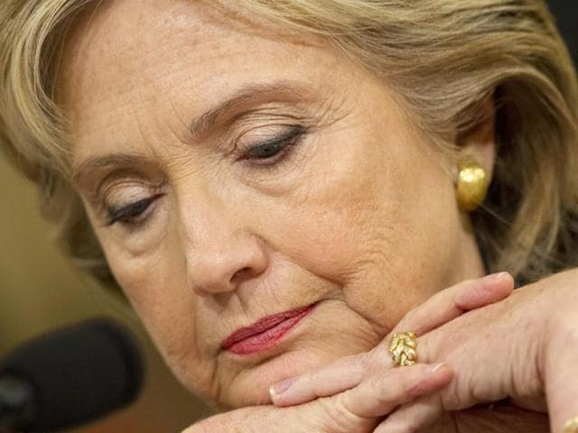 US Democratic presidential candidate and former Secretary of State Hillary Rodham Clinton, looks down during questioning on Capitol Hill in Washington.