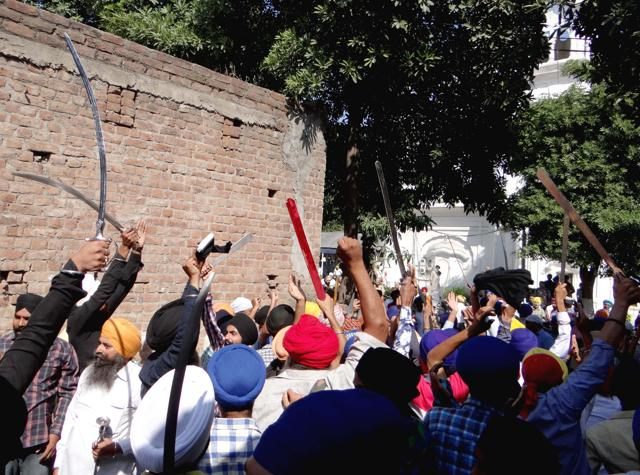 Sikh protestors armed with swords chanting pro-Khalistan and anti-SAD slogans at State Gurudwara in Kapurthala on Friday.