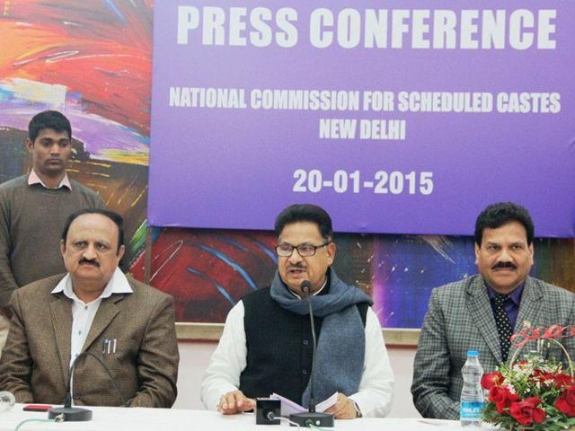 National Commission for Scheduled Castes chairman PL Punia (Centre) at a press conference. Punia has come under fire from the BJP after he mocked VK Singhs's controversial remarks about two Dalit children who were murdered in Faridabad earlier this week.(HT Photo)
