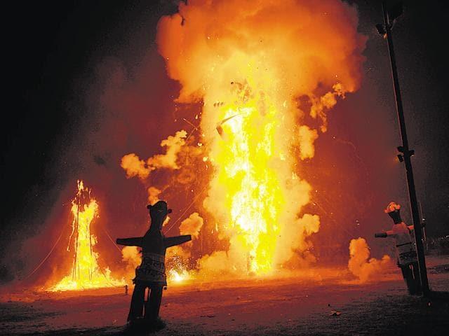 Effigies of Ravan, Kumbhkarana and Meghnath on the night of Dussehra at the Ramlila ground in Sector 21, Noida on Thursday.