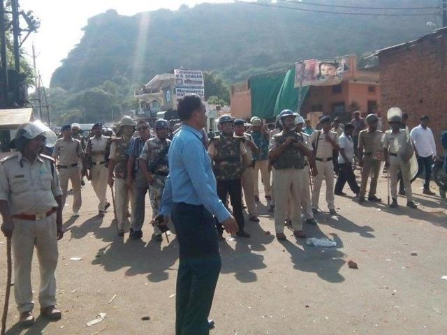 Policemen patrol the streets in Gwalior after violence in  parts of the town on Saturday.