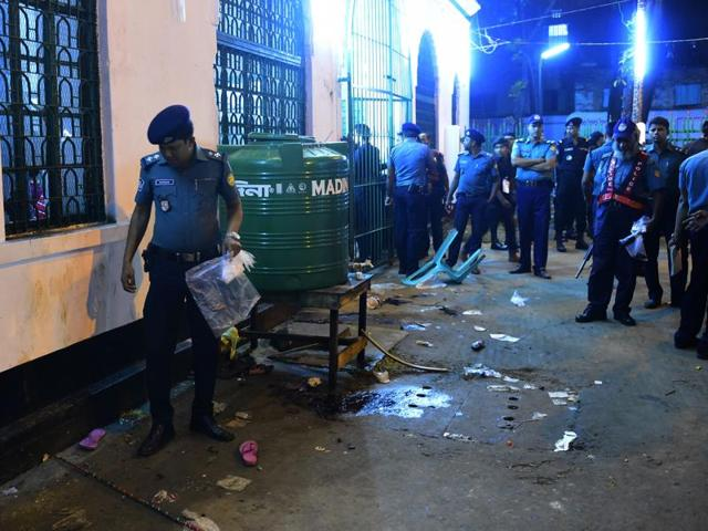 Bangladeshi security personnel stand guard after a small bomb exploded outside Bangladesh capital's main Shia religious site in Dhaka.