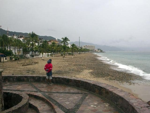 A man looks at the Ocean in Puerto Vallarta, Mexico on October 23 ,2015, during hurricane Patricia. Monster Hurricane Patricia roared toward Mexico's Pacific coast on Friday, prompting authorities to evacuate villagers, close ports and urge tourists to cancel trips over fears of a catastrophe.
