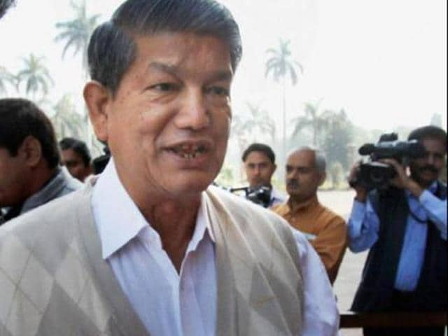 Chief minister Harish Rawat laid the foundation stone for the proposed school on Thursday amid massive protests by the residents of Nainisar.(PTI photo)