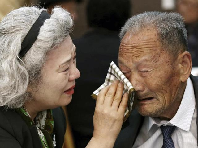 Lee Jeong-suk, 68, left, living in South Korea wipes the tears of her father Ri Hung Jong, 88, living in North Korea, during the Separated Family Reunion Meeting at Diamond Mountain resort in North Korea, Thursday, Oct. 22, 2015.