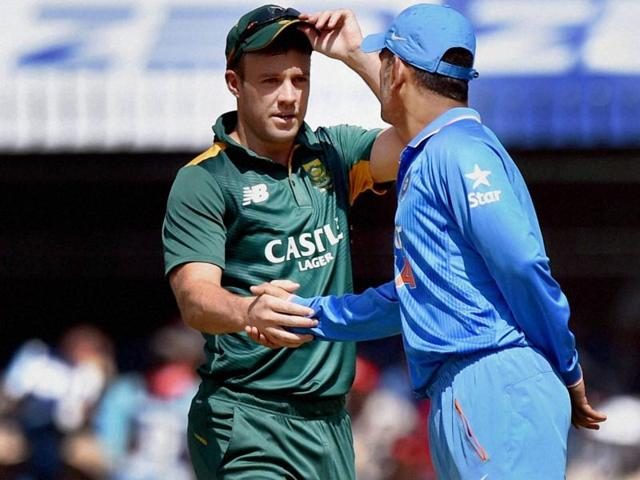 Indian cricket captain MS Dhoni shakes hands with his South African counterpart AB de Villiers during the toss for the 2nd ODI in Indore on October 14, 2015.
