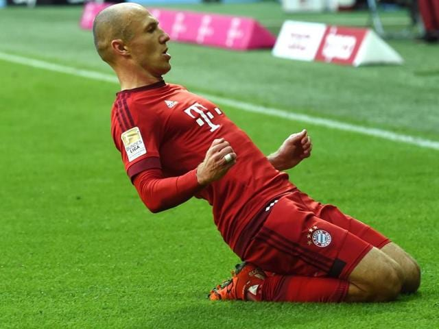 Arjen Robben, second from right, celebrates with teammates after scoring against FC Cologne during their Bundesliga match in Munich on October 24, 2015.