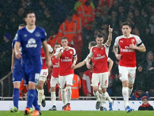 Arsenal's Olivier Giroud celebrates scoring his side's first goal during the EPL match against Everton at the Emirates Stadium in London, on October 24, 2015.