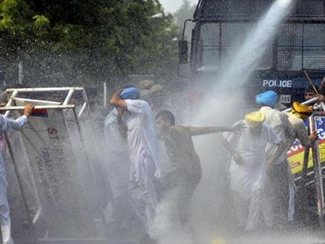 A file photo of the UT police using a water cannon on Simarjit Singh Bains and his supporters during their protest against the CM outside the CM House in Chandigarh on Wednesday, October 21, 2015.