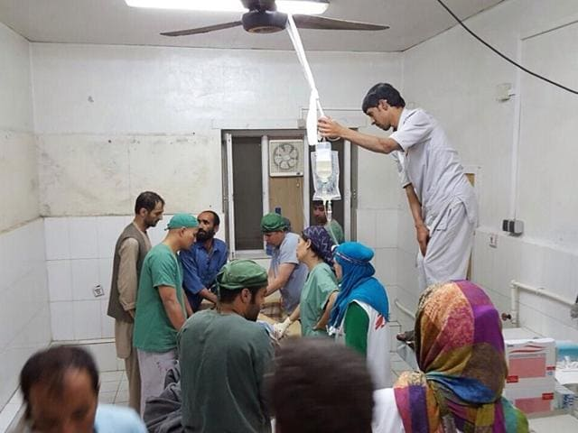 In this photograph released by Medecins Sans Frontieres (MSF) on October 3, 2015, Afghan MSF surgeons work in an undamaged part of the MSF hospital in Kunduz after the operating theatres were destroyed in an air strike