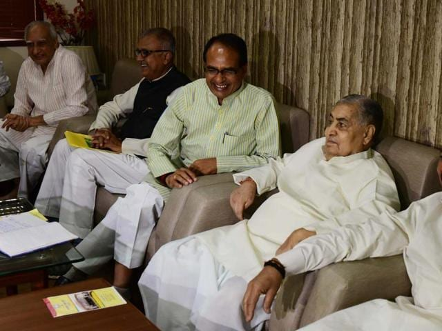 Chief minister Shivraj Singh Chouhan, senior party leader Kailash Joshi and others during BJP state election committee meeting in Bhopal on Sunday.