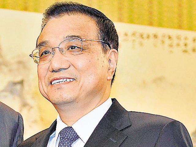 Chinese Premier Li Keqiang looks optimistic ahead of a key meeting this week important for the Chinese economy.