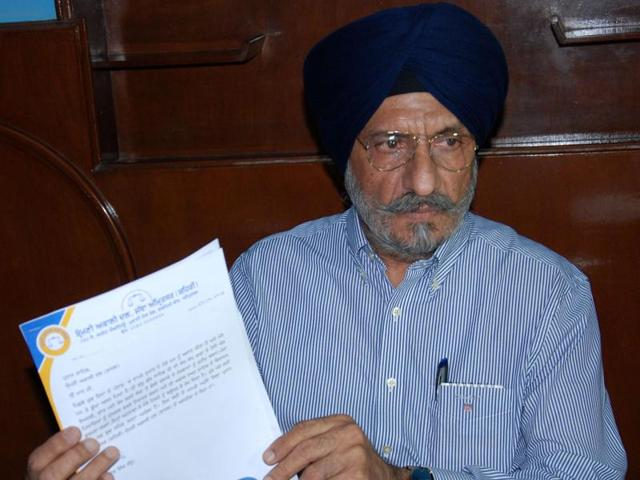 SAD district president and PEDA chairman Upkar Singh Sandhu shows his resignation letter during a press conference at his office in Amritsar on Saturday.