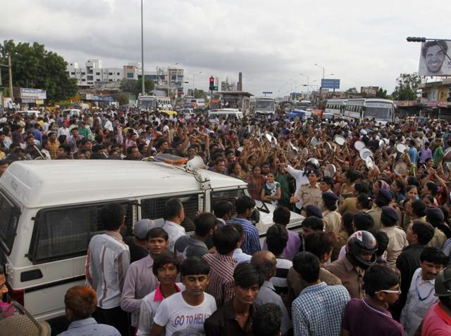 Members of Patel community block a highway during a protest after Hardik Patel, a firebrand leader of Patidar Andolan Samiti, was detained by police in Surat.