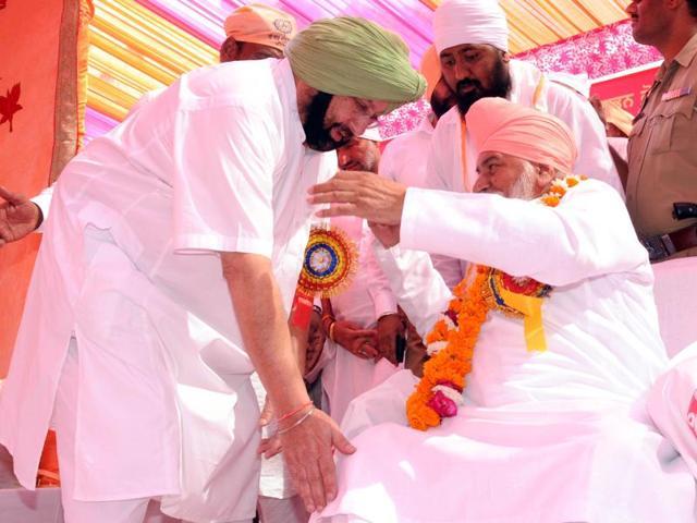 Amritsar MP Captain Amarinder Singh seeking blessings of Sant Niranjan Dass, the head of Dera Ballan, during a function at Guru Ravidas Temple in Patiala on Saturday.