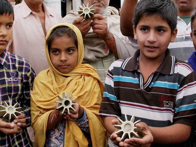 Jammu: Villagers showing mortar shells fired from across the border by Pakistan in a village of Sadoh, Samba district, on Sunday.