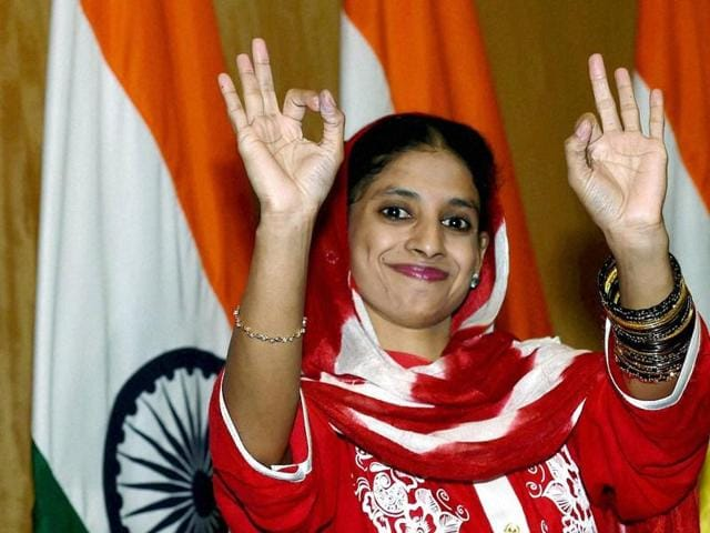 Geeta, a deaf-mute Indian woman who accidentally crossed over to Pakistan more than a decade ago, gestures at a press conference in New Delhi after her return to India.