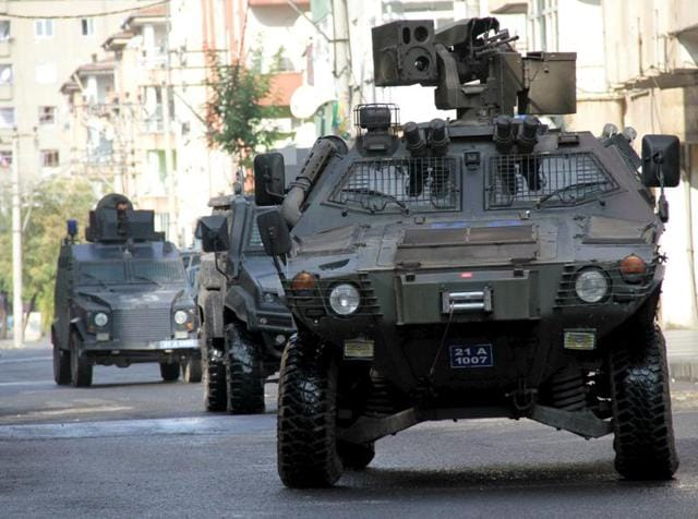 Members of Turkish police special forces in armoured vehicles take part in a security operation in Diyarbakir.