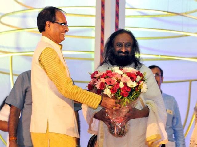 Chief minister Shivraj Singh Chouhan and spiritual guru Ravi Shankar at the valedictory session of international dharma-dhamma conference in Indore on Monday.
