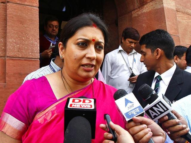 HRD minister Smriti Irani talks with media at the parliament House, in New Delhi. Irani said non-NET fellowships would continue and there was a need to include students from state universities in it. (HT file photo by Sanjeev Verma)