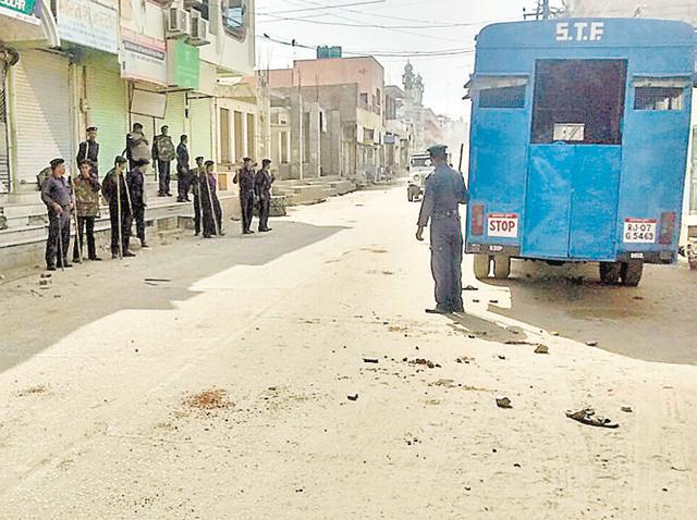 STF personnel patrol the closed Sridoongargarh market.