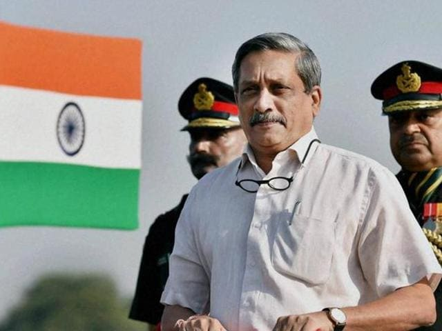 Defence minister Manohar Parrikar inspects the guard of honour during Territorial Army day parade in New Delhi.