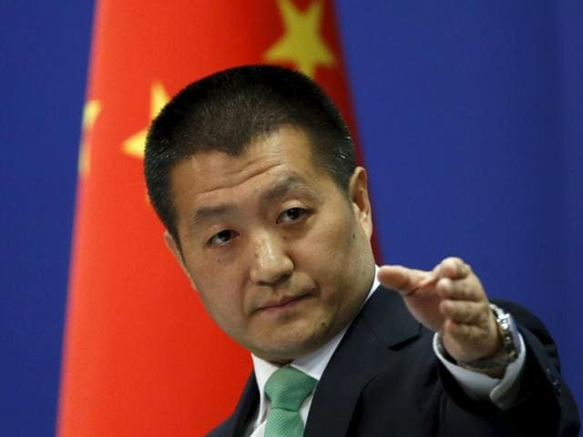 Chinese foreign ministry spokesperson Lu Kang points out a reporter to receive a question at a regular news conference in Beijing. The US Navy sent a guided-missile destroyer close to China's man-made islands in the disputed South China Sea, drawing an angry rebuke from Beijing, which said it warned and followed the American vessel.