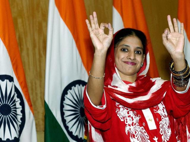 Geeta, a deaf-mute Indian woman who accidentally crossed over to Pakistan more than a decade ago gestures at a press conference in New Delhi on Monday. )(PTI Photo)