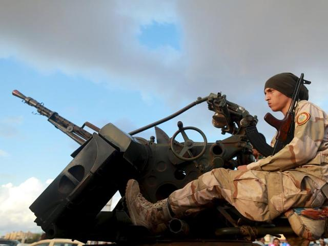 One of the members of the military protecting a demonstration against candidates for a national unity government proposed by UN envoy for Libya Bernardino Leon, is pictured in Benghazi, Libya.