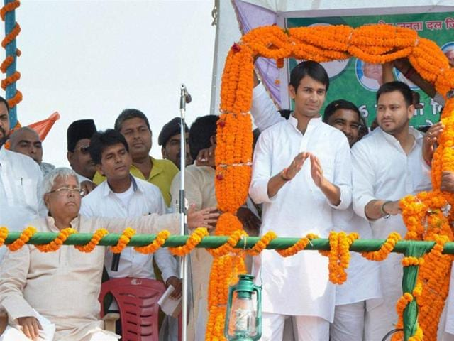 RJD chief Lalu Prasad with sons Tejaswi Yadav and Tej Pratap at a rally after the latter filed nomination papers from Mahula assembly constituency, in Hajipur.