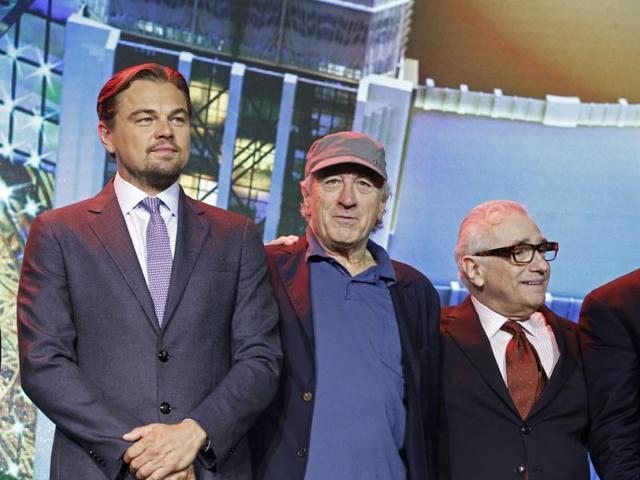 From left, film stars Leonardo DiCaprio, Robert De Niro and director Martin Scorsese pose for photos during a launching ceremony of the Studio City project in Macau.
