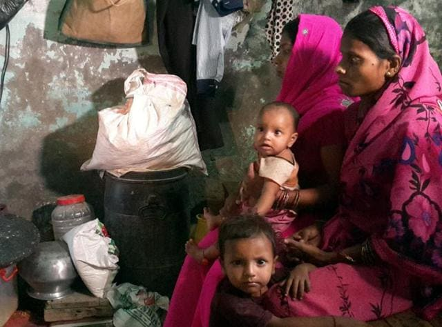 Members of a Ludhiana family who claim Geeta to be their daughter watching news of her arrival in India on Monday.