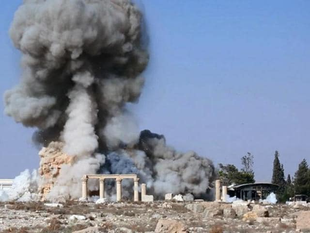 This undated photo released on a social media site used by Islamic State militants, which has been verified and is consistent with other AP reporting, shows smoke from the detonation of the 2,000-year-old temple of Baalshamin in Syria's ancient caravan city of Palmyra.